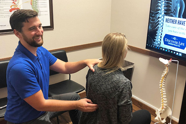 Spinal examination with Dr. Joey Kelbel at Discover Life Chiropractic in Madison, WI